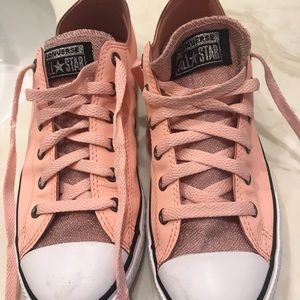 Converse pink sparkly shoes.